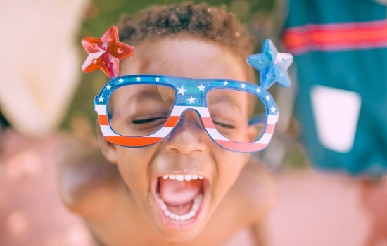 Happy boy with American flag glasses