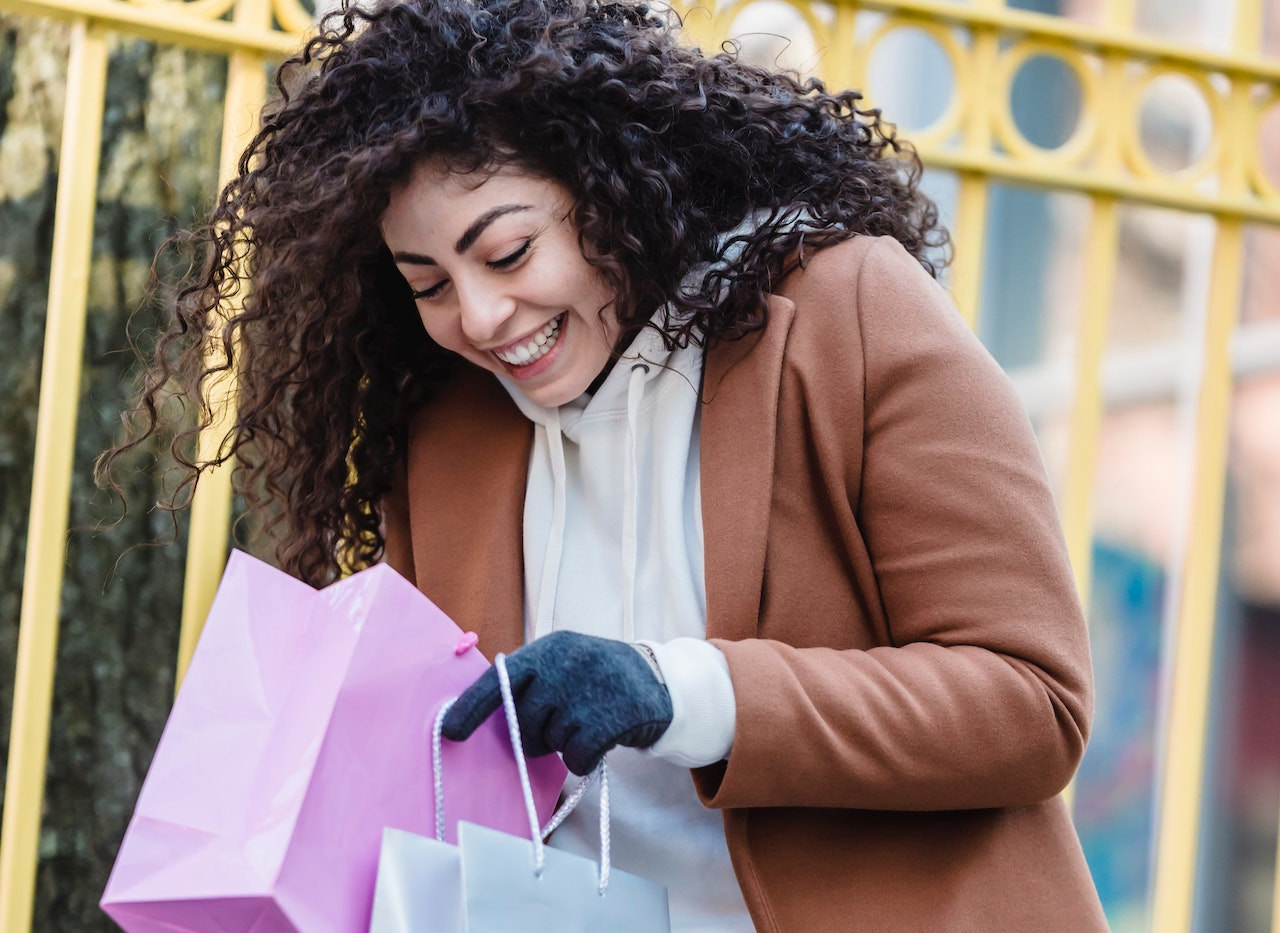 Excited customer looks in shopping bags