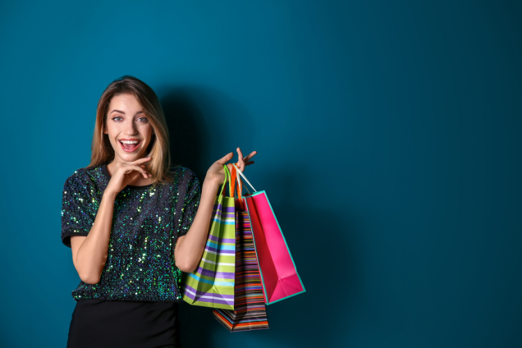 Happy woman ecommerce customer holds shopping bags
